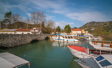 Anchored tourists boats near the bridge in Virpazar town, Montenegro