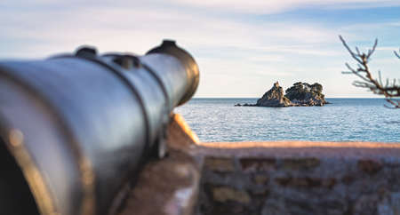 Medieval cannon gun directed on the old Monastery, walls of the old Petrovac old town fortress, Montenegro