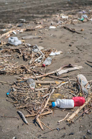 Large amounts of of the sea washed up rubbish, garbage and plastic bottles on the shore of once beautiful Velika Plaza near Ulcinj, Montenegro Фото со стока