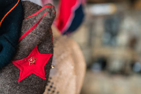 Red star with sickle and hammer attached to the  traditional Balkan folk costume Standard-Bild