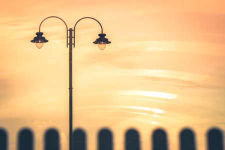 Picture of a street lamp during orange sunset, Penzance, Cornwall, Uk Archivio Fotografico