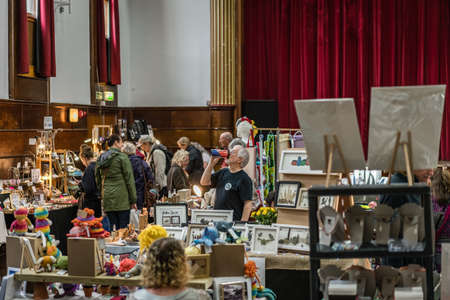 St. Ives, England -  May 2018 : People looking for a bargain on an art and antique flea market Stock fotó - 119471391