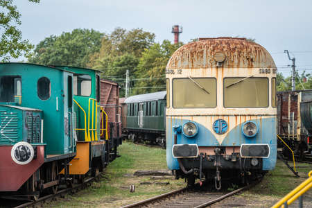 Jaworzyna Slaska, Poland - August 2018 : Old disused blue and yellow passenger train on the side track in the Museum of Industry and Railway in Silesia