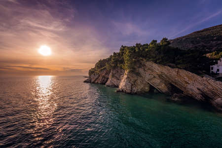 Beautiful sunset over the cliffs in Petrovac coast, Montenegro