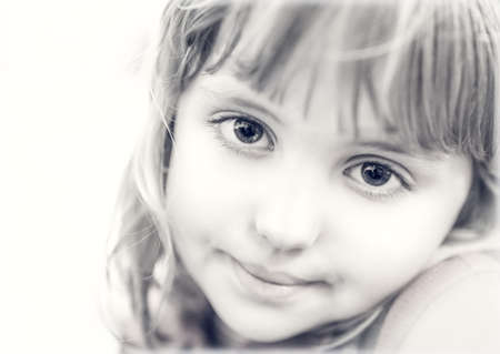 Black and white portrait of a cute little Caucasian toddler girl