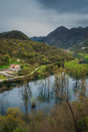 Small countryside village home and the road going along Rijeka crnojevica to the Skadar Lake National Park, Montenegro Stock Photo