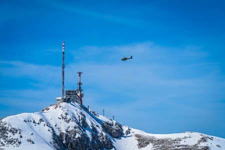 Helicopter flying above telecommunication station on the Stirovnik peak, the highest summit of the Lovcen National Park, Montenegro