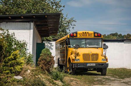 Jaworzyna Slaska, Poland - August 2018 : Big yellow school bus parked in the Museum of Industry and Railway