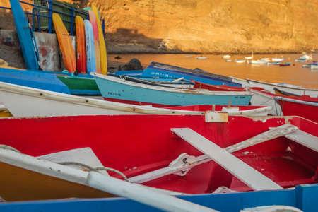 La Gomera, Spain - April 2013 : Red and blue boats in La Gomera port, Canary Islands