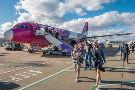 Luton, England - September 2018 : Passengers leaving the WizzAir plane after landing