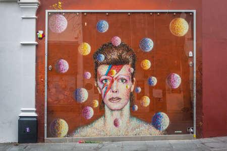 London, England - December 2018 : Graffiti in memory of singer David Bowie as Ziggy Stardust, Brixton