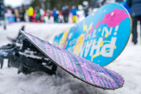 Szklarska Poreba, Poland - February 2019 : Colorful snowboards left in the snow on the mountain slope in winter