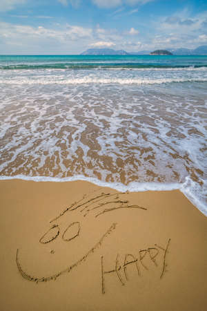Happy face drawn on sand  Gerakas Beach in summer, Zante Island, Greece