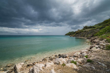 Stormy dramatic clouds accumulating over Alykes Beach in Zante Island, Greece