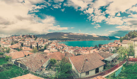Panoramic image of hillside red tiled rooftop houses on the shore of Lake Ohrid, Northern Macedonia