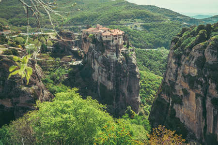 View of the stunningly located Roussanou monastery in Meteora valley, Greece