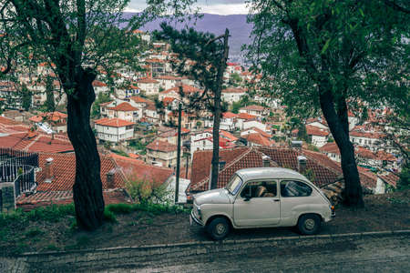 Ohrid, Northern Macedonia -  April 2019 : White mini beetle-like car parked on a cobblestoned street in Ohrid Old Town Editoriali