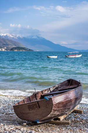 Old brown wooden boat on the shore of Lake Ohrid, Republic of Macedonia