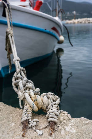 Close up of a rope holding empty fisherman boat moored in port, Zante, Greece