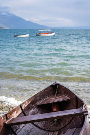 Old brown wooden boat on the shore of Lake Ohrid, Republic of Macedonia Stok Fotoğraf - 130150598