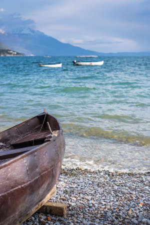 Old brown wooden boat on the shore of Lake Ohrid, Republic of Macedonia Stok Fotoğraf - 130150609