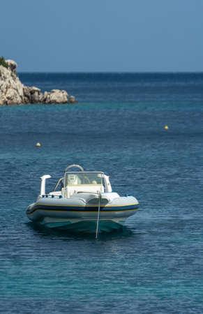 Private small speedboat moored on the shore in Agios Nikolaos bay on Zakynthos Island, Greece Zdjęcie Seryjne