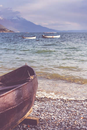 Old brown wooden boat on the shore of Lake Ohrid, Republic of Macedonia Stok Fotoğraf - 130150623