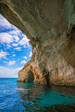 Stone arch entrance to one of the many Blue Caves in Zante Island, Greece