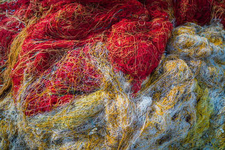 Tangled colorful fisherman fishing nets on the shore of in Zante Island, Greece Stock Photo