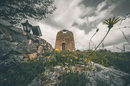 Remnants of an old windmill in Askos, Zakynthos island, Greece