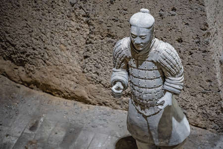 Xian, China -  July 2019 :  Standing clay soldier forming part of an army of terracota warriors, created during the reign of first chinese emperor Qin Shi Huang Di, Shaanxi Province Redakční