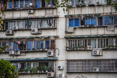 Windows and balconies of old residential buildings and blocks of flats in Chengdu, China