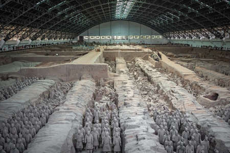 Xian, China -  July 2019 : An army of terracota clay soldiers, created during the reign of first chinese emperor Qin Shi Huang Di, Xian, Shaanxi Province