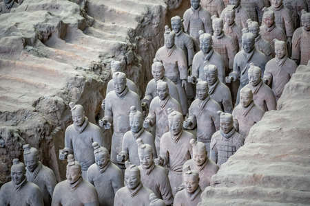 Xian, China - July 2019 : Standing clay soldiers forming part of an army of terracota warriors, created during the reign of first chinese emperor Qin Shi Huang Di, Shaanxi Province