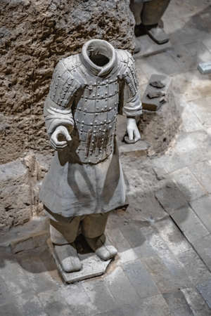 Xian, China -  July 2019 :  Standing clay soldierarmour forming part of an army of terracota warriors, created during the reign of first chinese emperor Qin Shi Huang Di, Shaanxi Province,