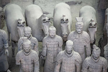 Xian, China - July 2019 : Standing clay soldiers forming part of an army of terracota warriors, created during the reign of first chinese emperor Qin Shi Huang Di,Shaanxi Province