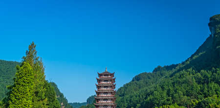 Traditional chinese style wooden tower pagoda standing at the Wulingyuan entrance to the Zhangjiajie national park, Hunan Province, China