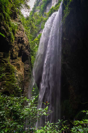 Giant Waterfall in a valley gorge in the Longshuixia Fissure National park, Wulong country, Chongqing, China
