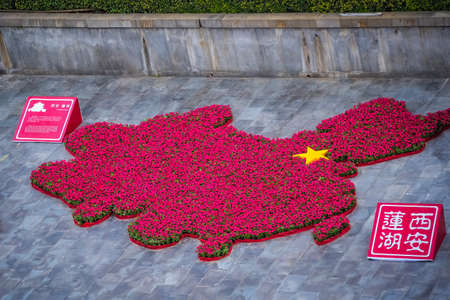 Xian, China -  July 2019 : Map of China made of flowers seen from the viewing balcony of the Drum Tower, Xian city, Shaaxi Province