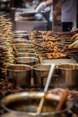 Portions of meat on wooden sticks, ready to be grilled on the street in the Muslim Quarter, Xian town, China