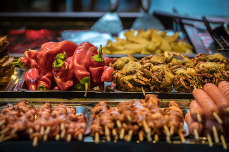 Hot buffet ingredients including peppers, crabs and sausage and meat sticks, ready to be grilled on the street in the Muslim Quarter, Xian town, China
