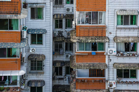 Zigong, China - July 2019 : Rooftops, windows and balconies of old residential buildings, blocks of flats and council living apartments in Zigong town, Sichuan Province