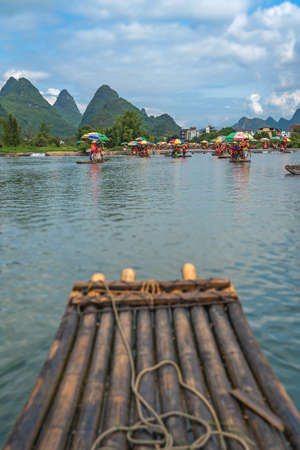 Yangshuo, China - August 2019 : Close up of bamboo raft for carrying tourists steered by guides on scenic and beautiful Yulong River