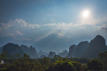 Beautiful impressive karst mountain landscape in Yangshuo on a sunny hot overcast summer day, Guangxi Province, China