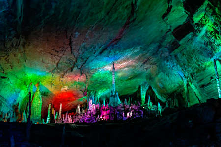 Colourful lights illuminating the stunning interior of the beautiful Huanglong Yellow Dragon Cave called also the Wonder of the World`s Caves, Zhangjiajie, Hunan province, China