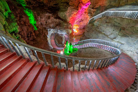 Illuminated turning and winding stairs and walking trail path inside the stunning and beautiful Huanglong Yellow Dragon Cave called also the Wonder of the World`s Caves, Zhangjiajie, Hunan province, China