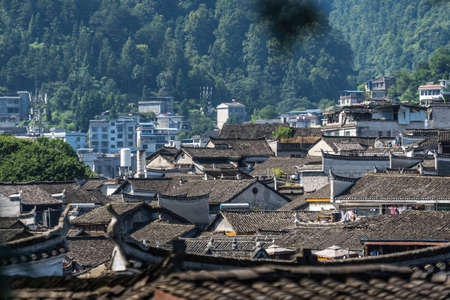Feng Huang, China -  August 2019 : View of tiled rooftops of historic old buildings in Fenghuang Old Town, Hunan Province
