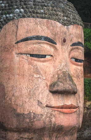 The close up of the head of the Giant Leshan Buddha, a 71-meter tall stone statue built between 713 and 803 during the Tang Dynasty. Located at the confluence of the Minjiang, Dadu and Qingyi rivers in the southern part of Sichuan province, China