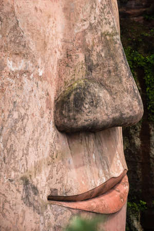 The close up of the nose and lips of the Giant Leshan Buddha, a 71-meter tall stone statue built between 713 and 803 during the Tang Dynasty. Located at the confluence of the Minjiang, Dadu and Qingyi rivers in the southern part of Sichuan province, China