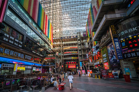 Chongqing, China - August 2019 : Interior of the modern commercial and business shopping centre building in the Jiefangbei district in the downtown of Chongqing city